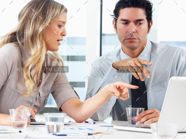demo-attachment-1152-businessman-and-businesswoman-meeting-in-office-PZZXTMB