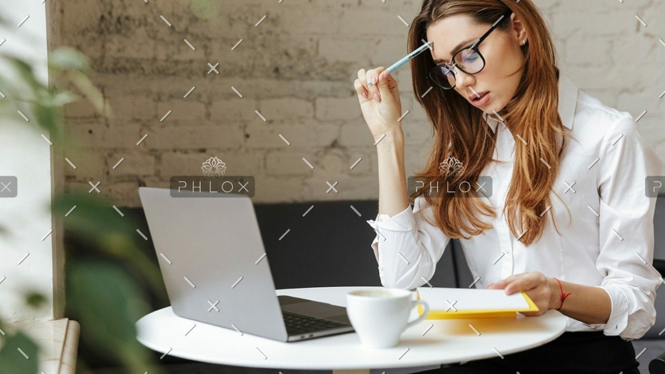 demo-attachment-1151-thoughtful-business-woman-indoors-using-laptop-P5HYUQX